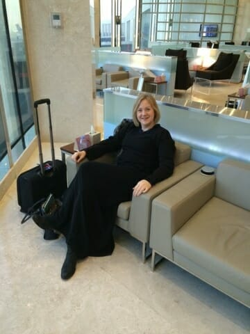 Me in my abaya lounging at the airport - what to wear in Saudi Arabia