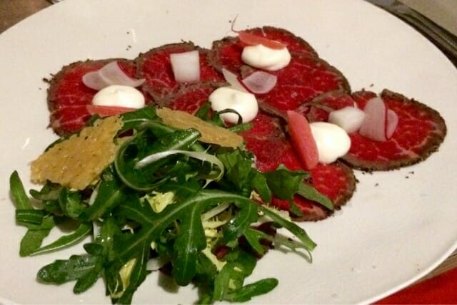 Peppered beef carpaccio - with goat cheese and rocket.