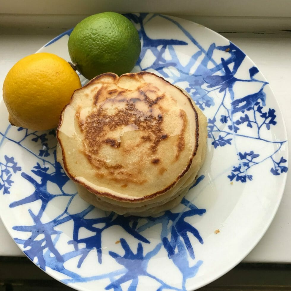 Gin and tonic pancakes on plate with a lemon and lime