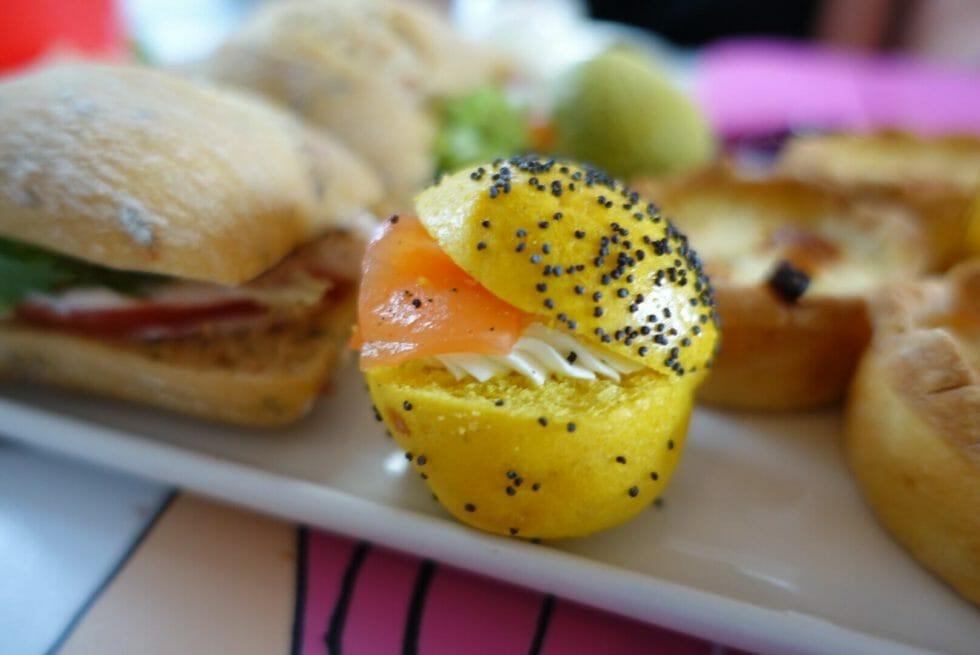 Close up of the yellow mini smoked salmon bagel