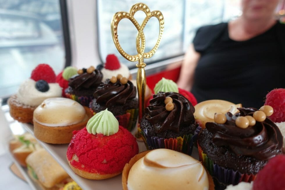 The top layer of the cake stand full of sweet treats on the B-Bakery bus tour tea