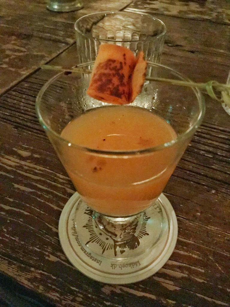 My Tvye Tyve gin cocktail with carrot garnish