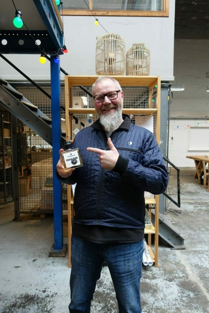 Master distiller Henrik Brinks holding his award winning Oak Gin