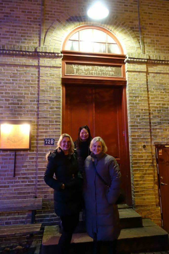 Us girls posing in front of the main door