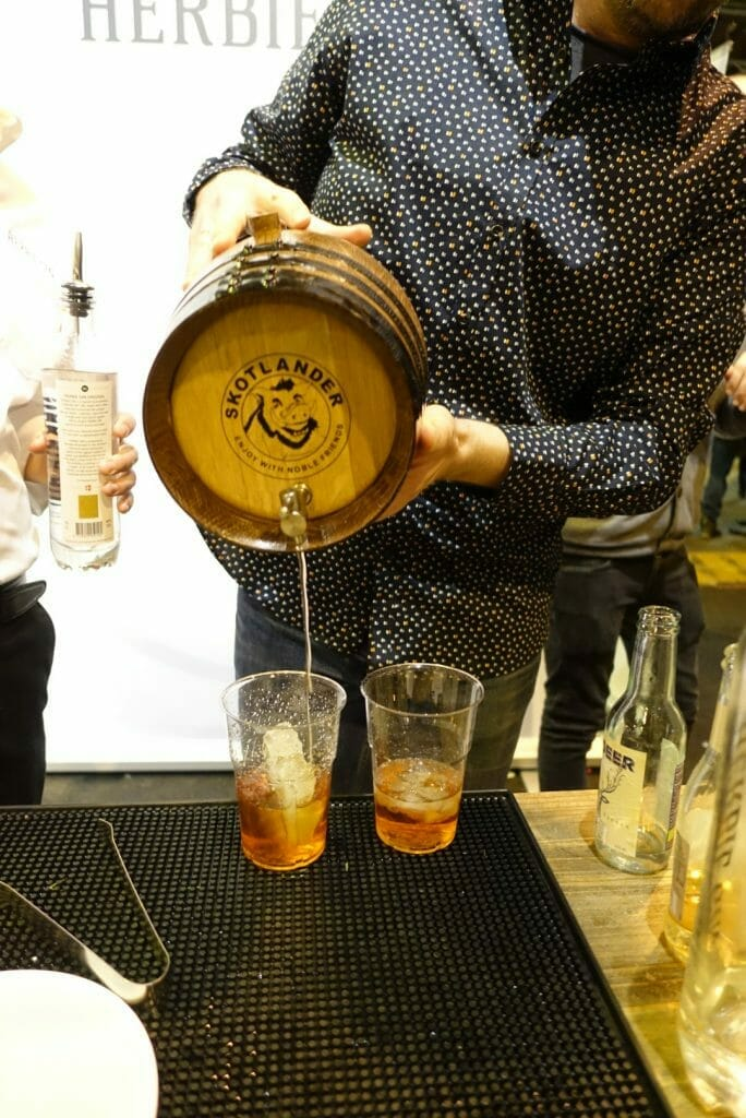Herbie barrel aged negroni being poured out