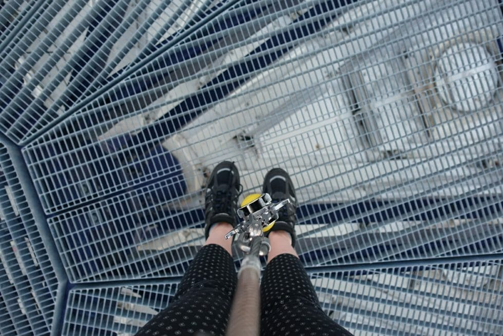 Shot looking down at Katie's feet with the carabineer dangling