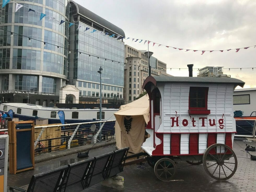 HotTug HQ - the yurt behind the cart was where you could change. The barge behind that is St Peter's floating church
