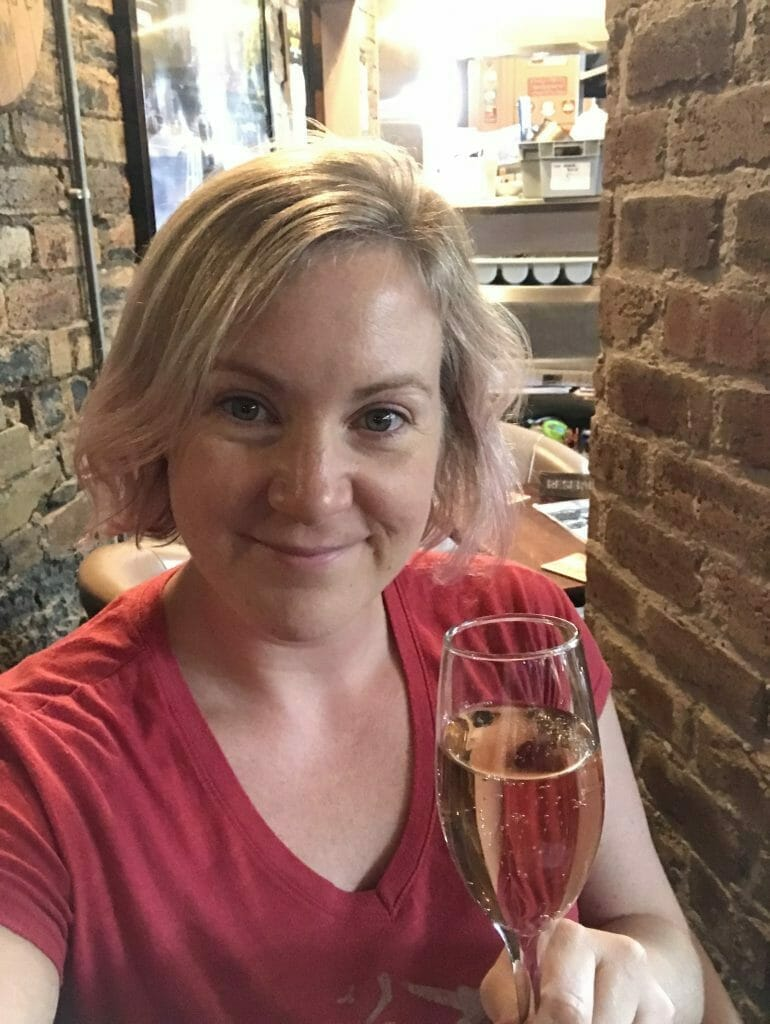 Katie with her gin liqueur and prosecco drink on the Edinburgh Gin Safari