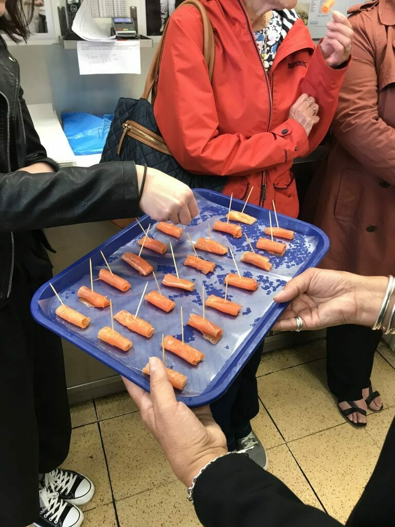 A blue tray of smoked salmon samples to try
