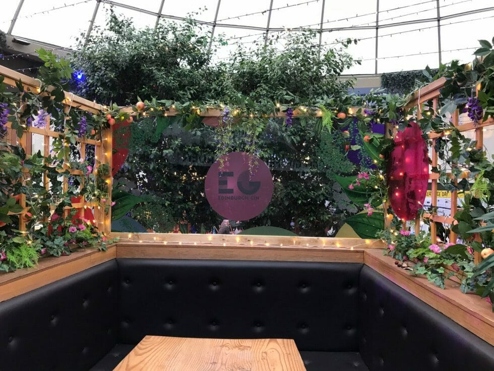 The Edinburgh Gin bar covered in flowers at the student union