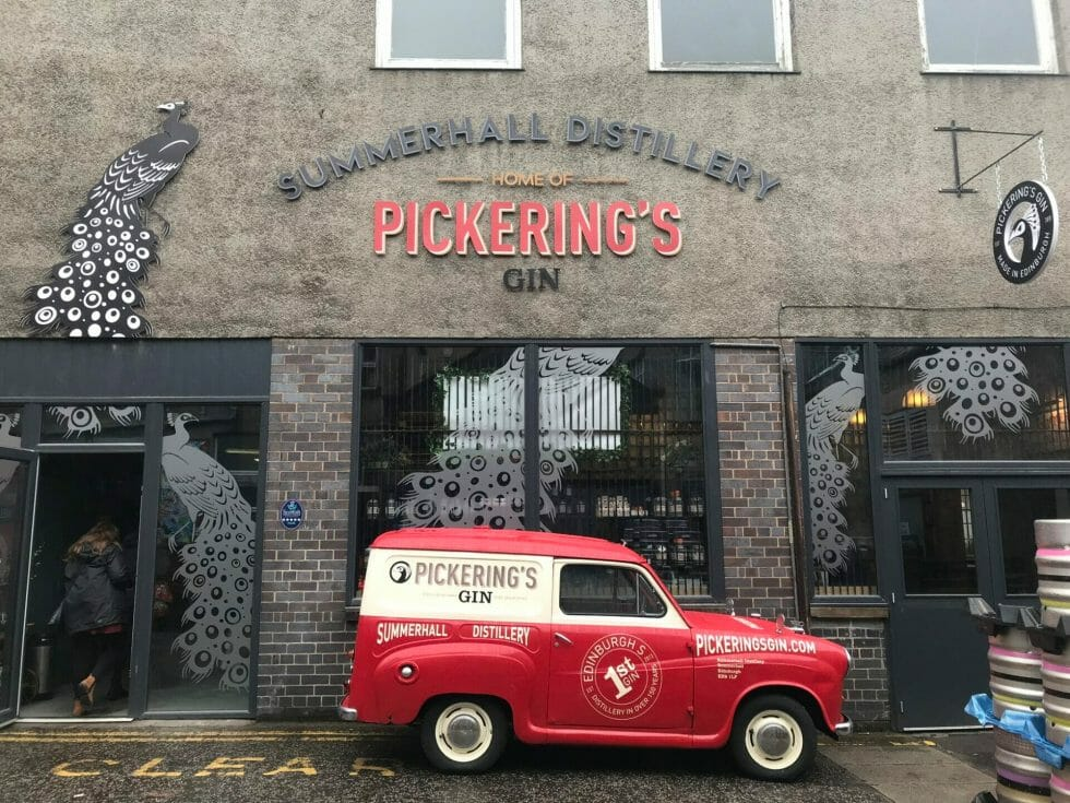 The outside of Pickering's distillery at Summerhall with red Pickering's van parked out front