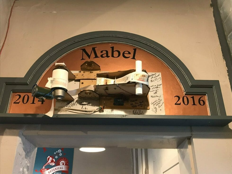 Mabel - the old labelling machine that is now retired and has pride of place on the wall at the distillery
