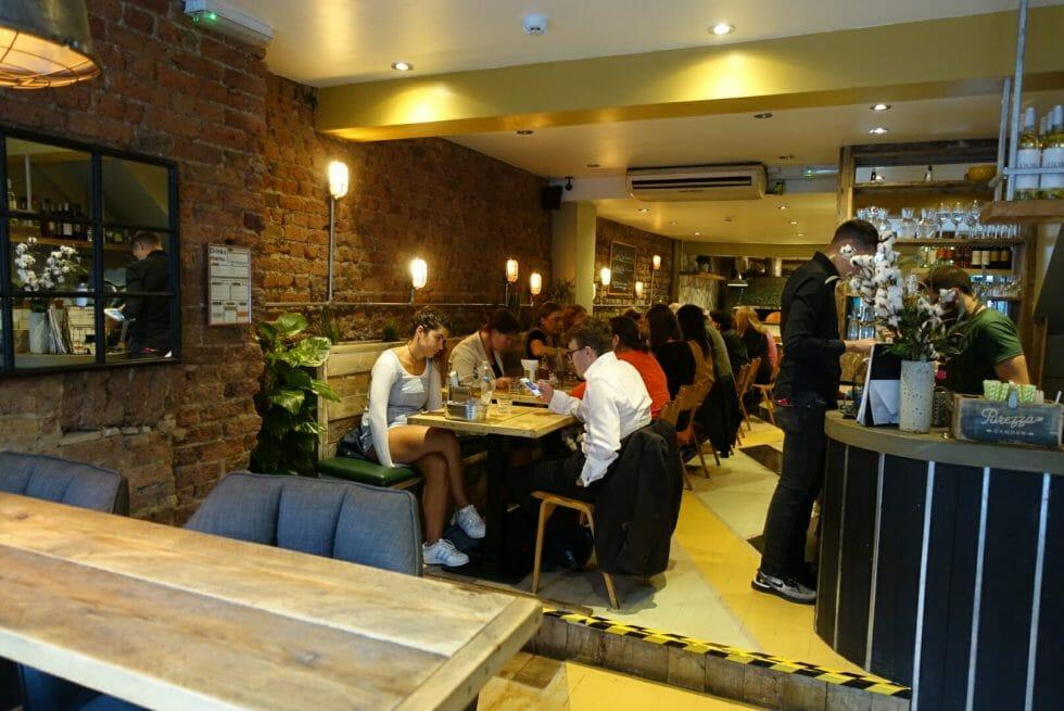 View of the inside of Purezza vegan pizzeria restaurant in Camden