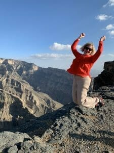 Katie jumping at the Grand Canyon wearing her trail running trainers