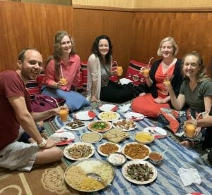 The group sitting on the floor for a traditional Omani meal