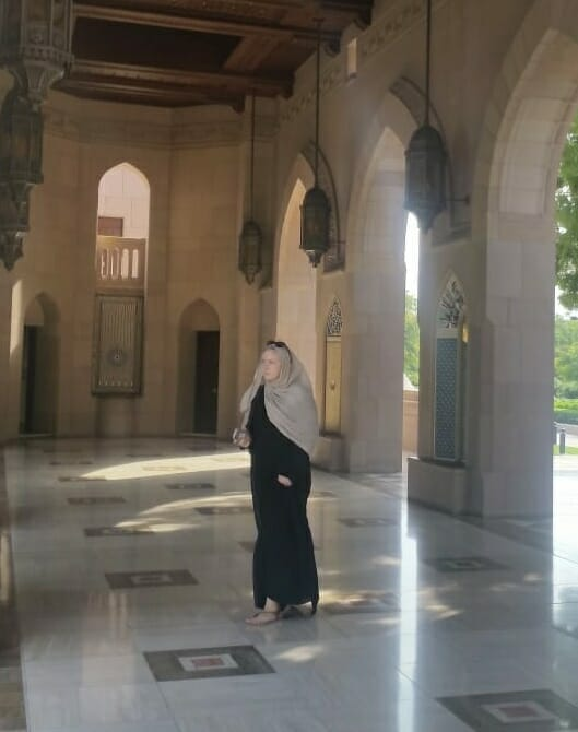 Katie walking in her abaya and head scarf at the Grand Mosque