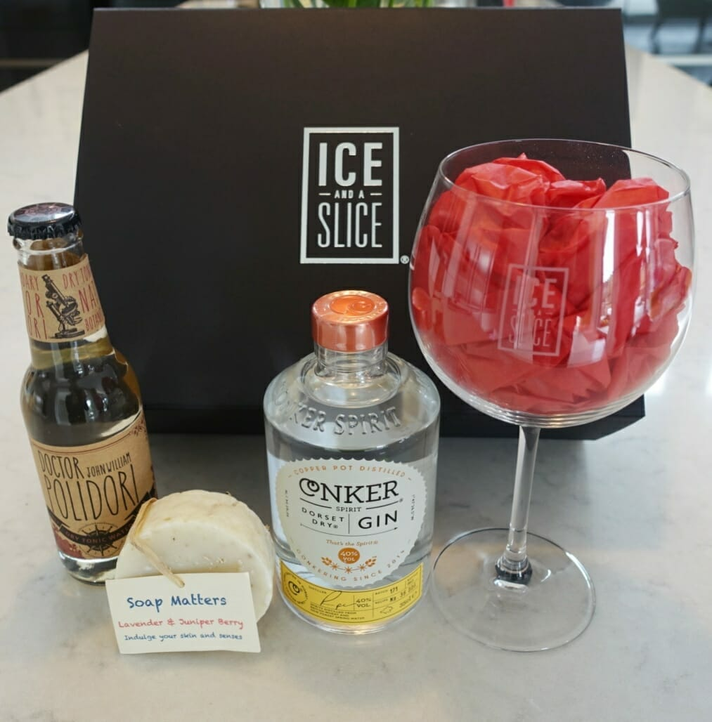 The Ice and a Slice black presentation box with all the goodies lined up in front
