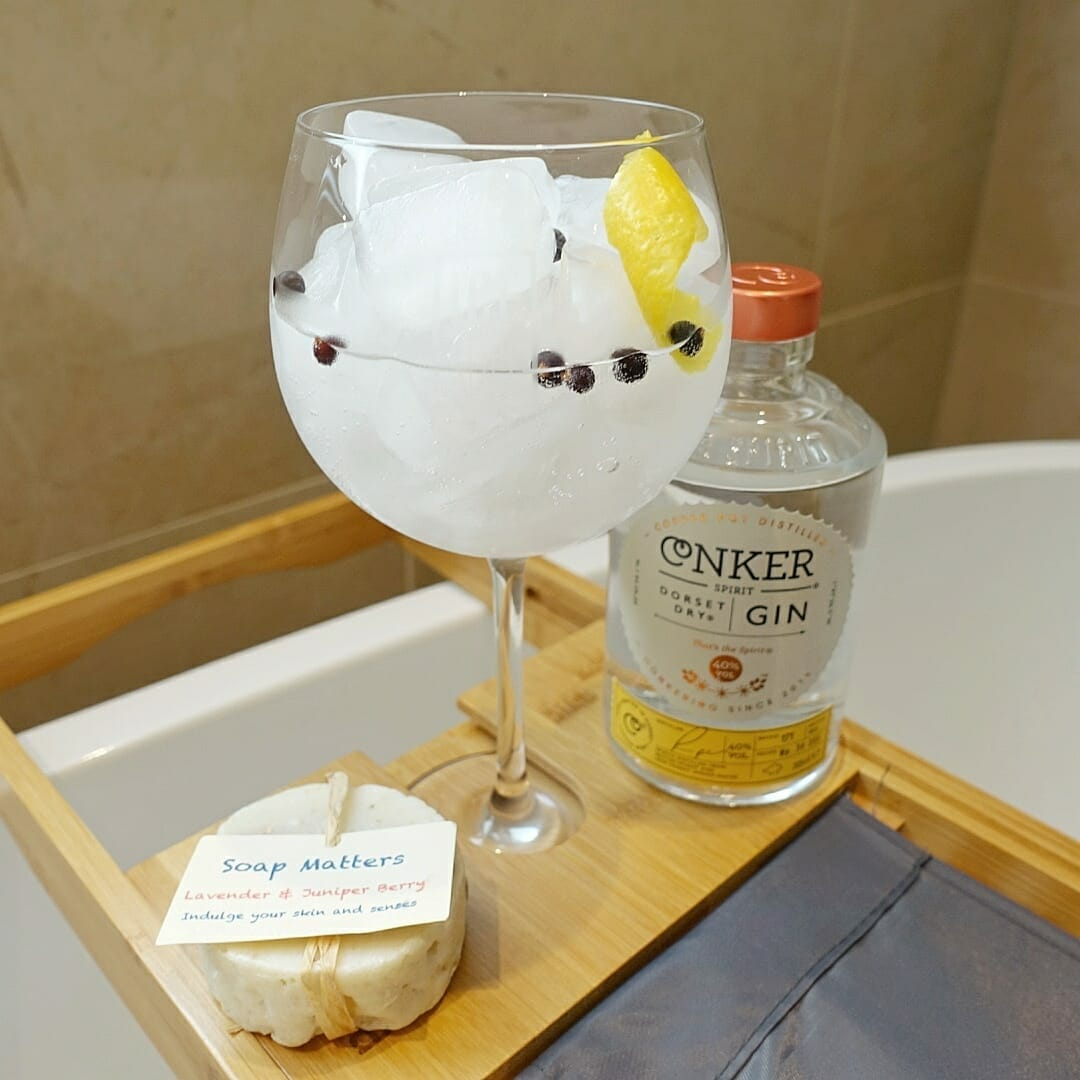 Gin and tonic with Conker bottle and soap on the bath tray