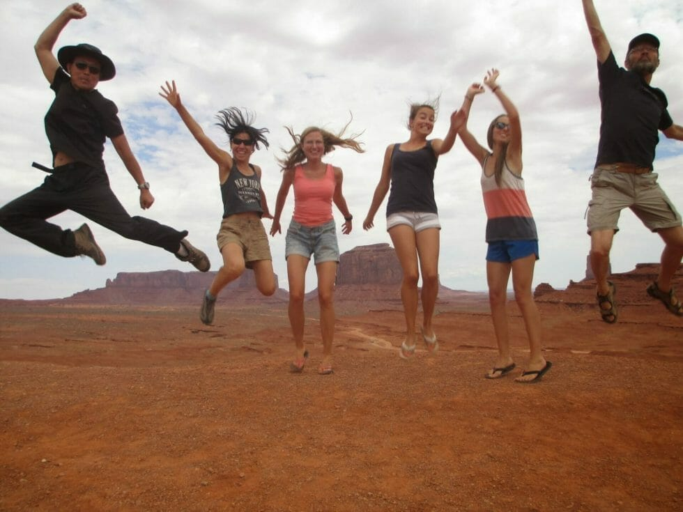Jump shot in Monument Valley Utah on a Green Tortoise tour