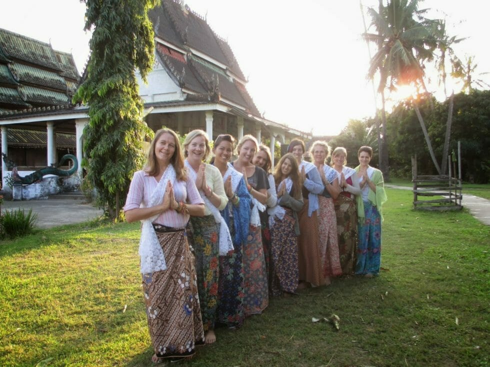 Katie and friends in traditional dress in Laos with Stray