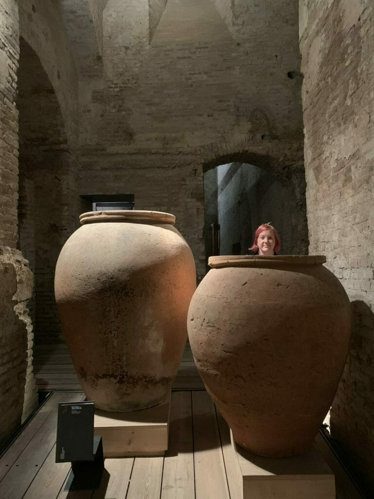 Katie popping up 'in' (behind) a giant amphora