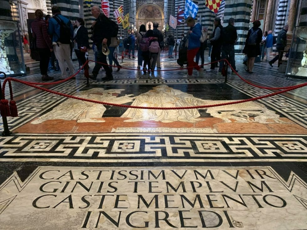 The inlaid marble floor and stripy columns