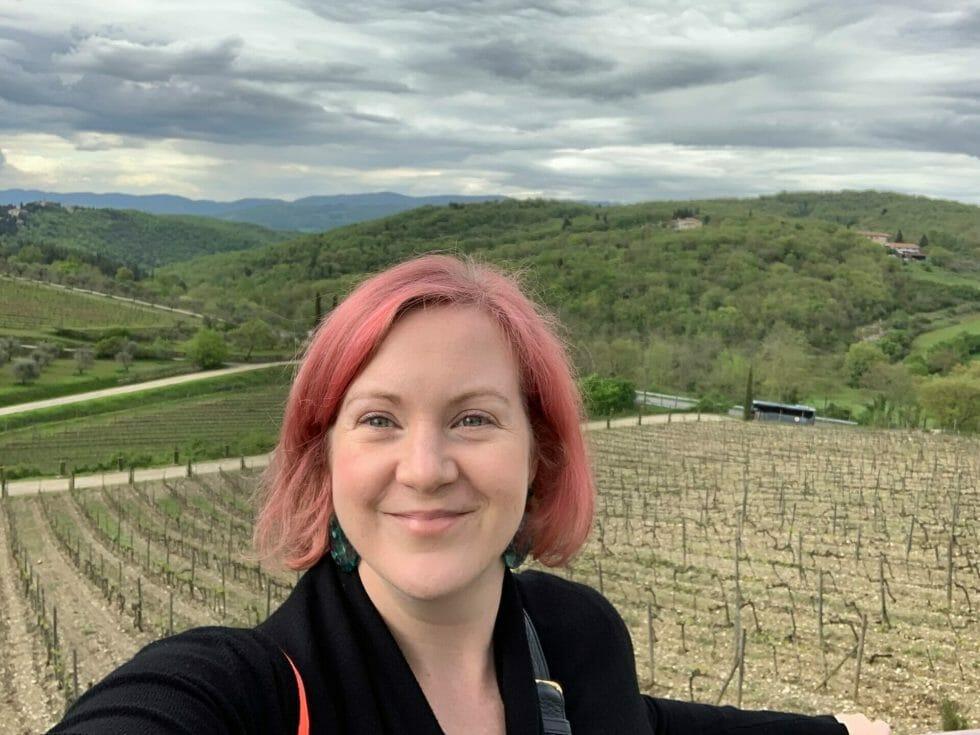 Katie in front of the vineyards