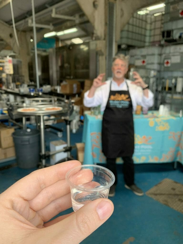 Sample of gin held up in front of the camera