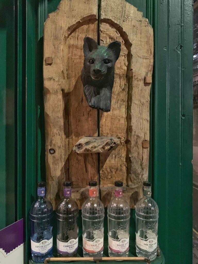 Cat statue mounted on old wooden door