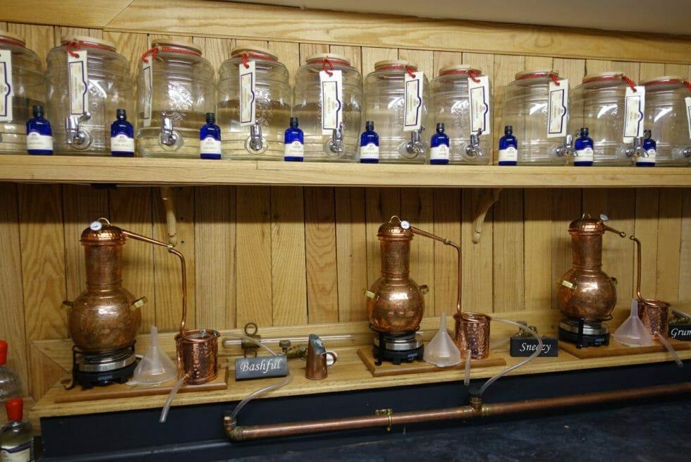 Stills and glass jars of single botanical distillates