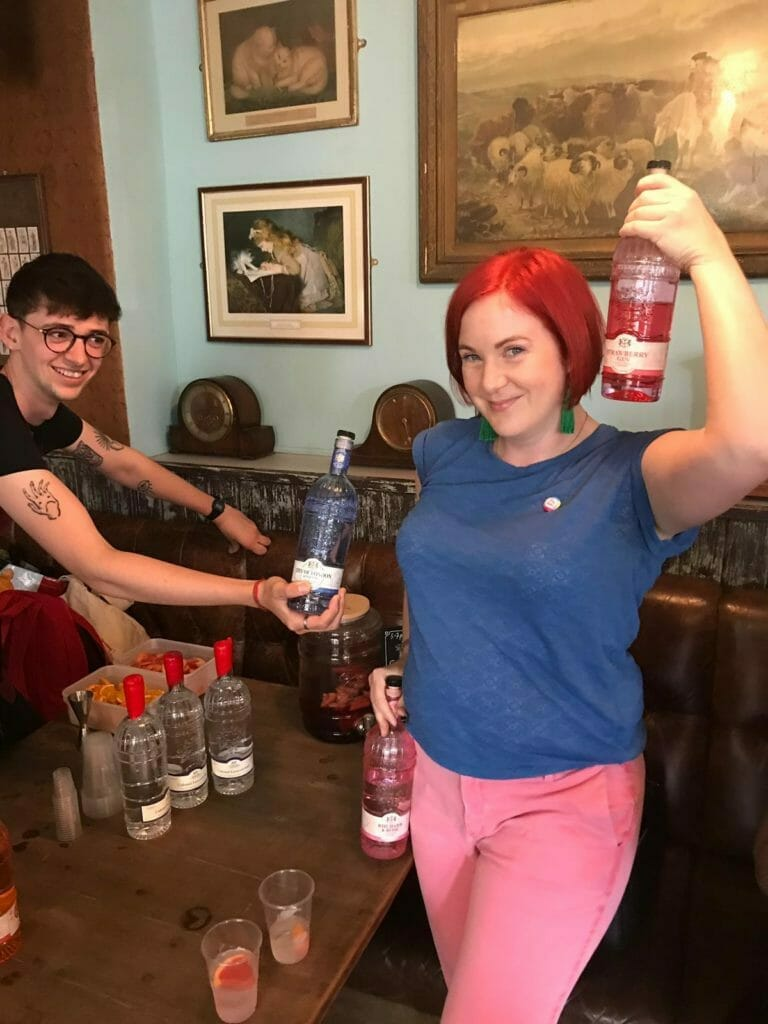 Katie matching the blue and pink gin bottles