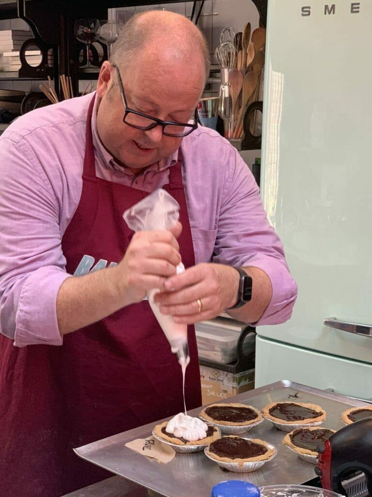 James piping meringue
