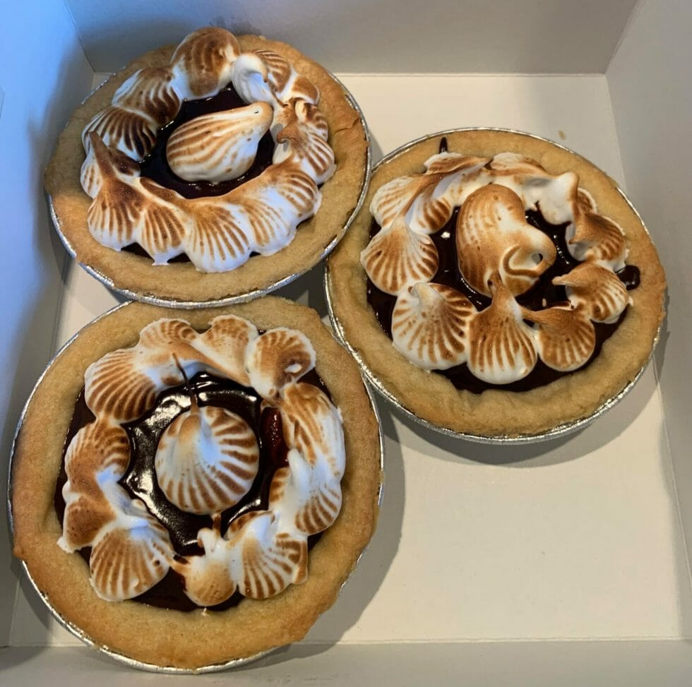 Three tarts in a cake box for transportation