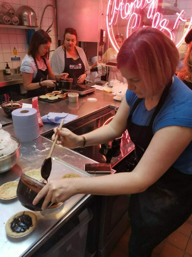 Katie pouring ganache