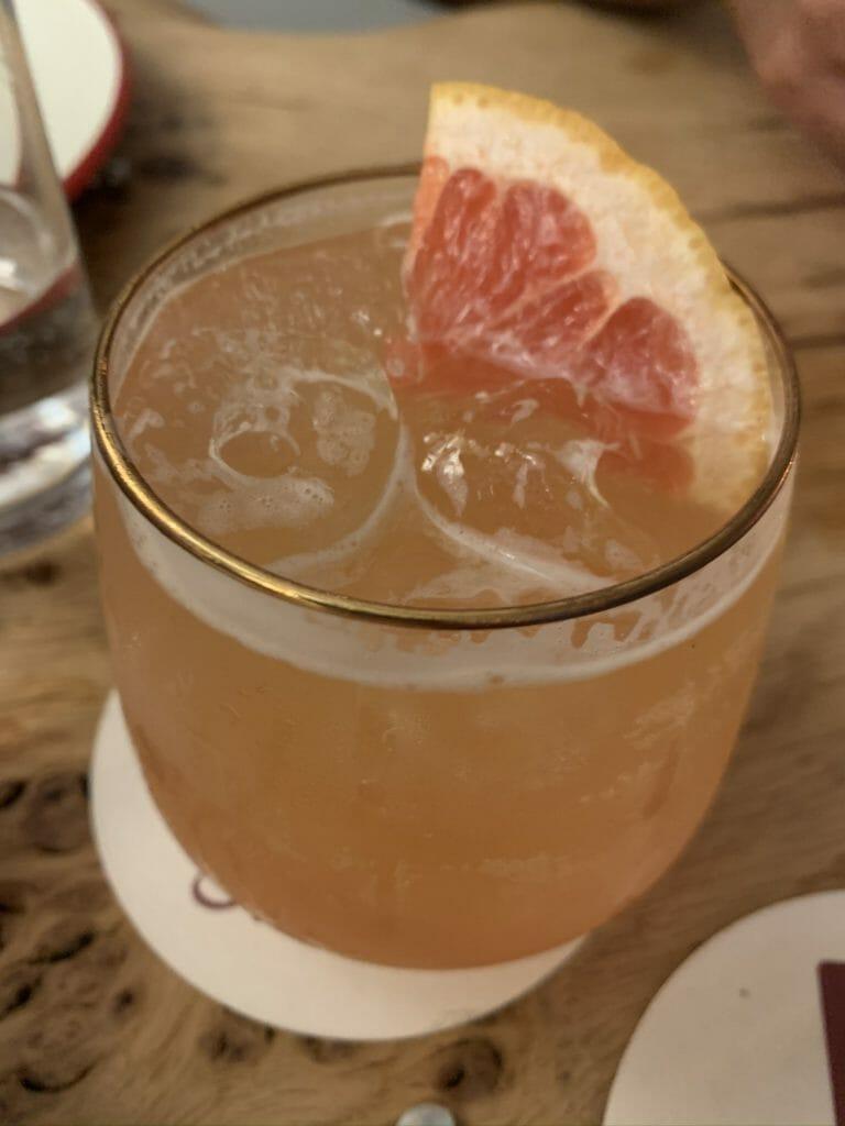Drambuie cocktail with pink grapefruit garnish