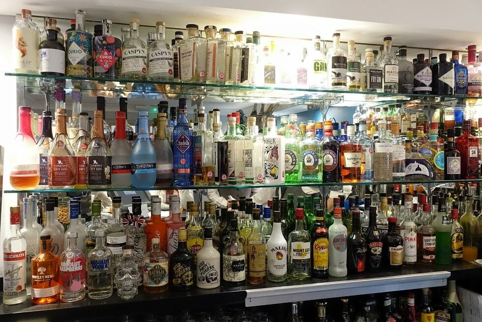 The back bar at the Talland Bay Hotel with lots of gin bottles