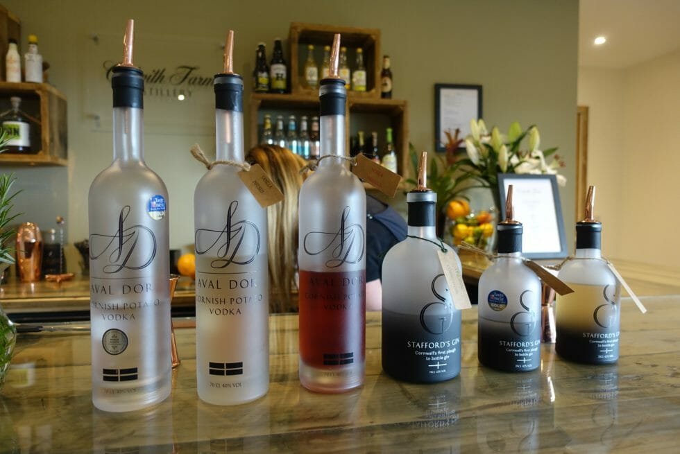 Bottles lined up on the Colwith Farm Distillery bar