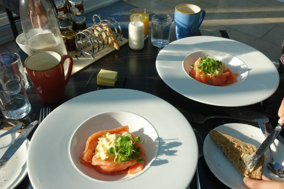 Table with two dishes of eggs with smoked salmon