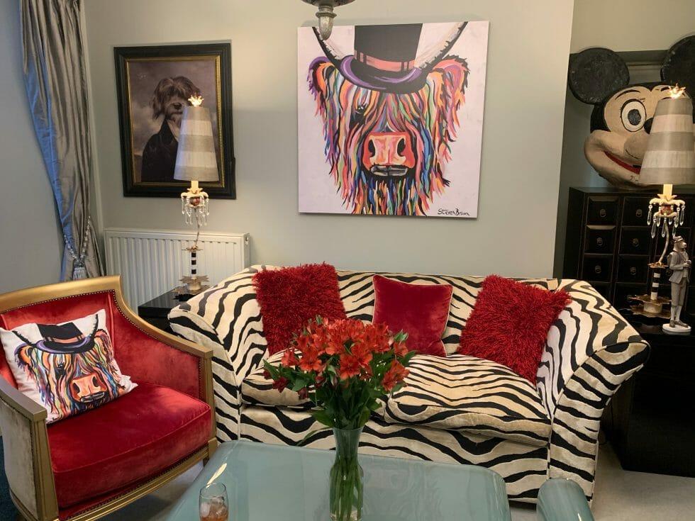 Animal paintings and zebra print sofa