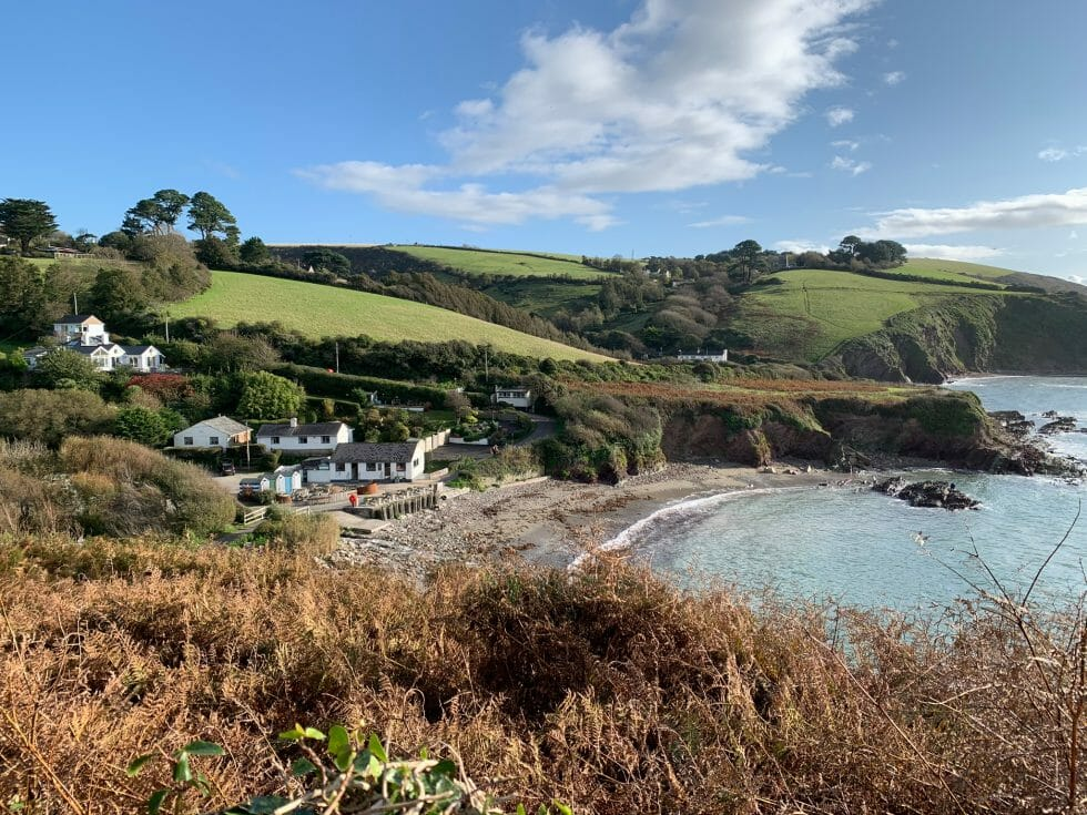 View back across Talland bay in the sunshine