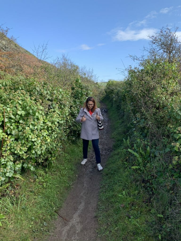 Meena astride a muddy path