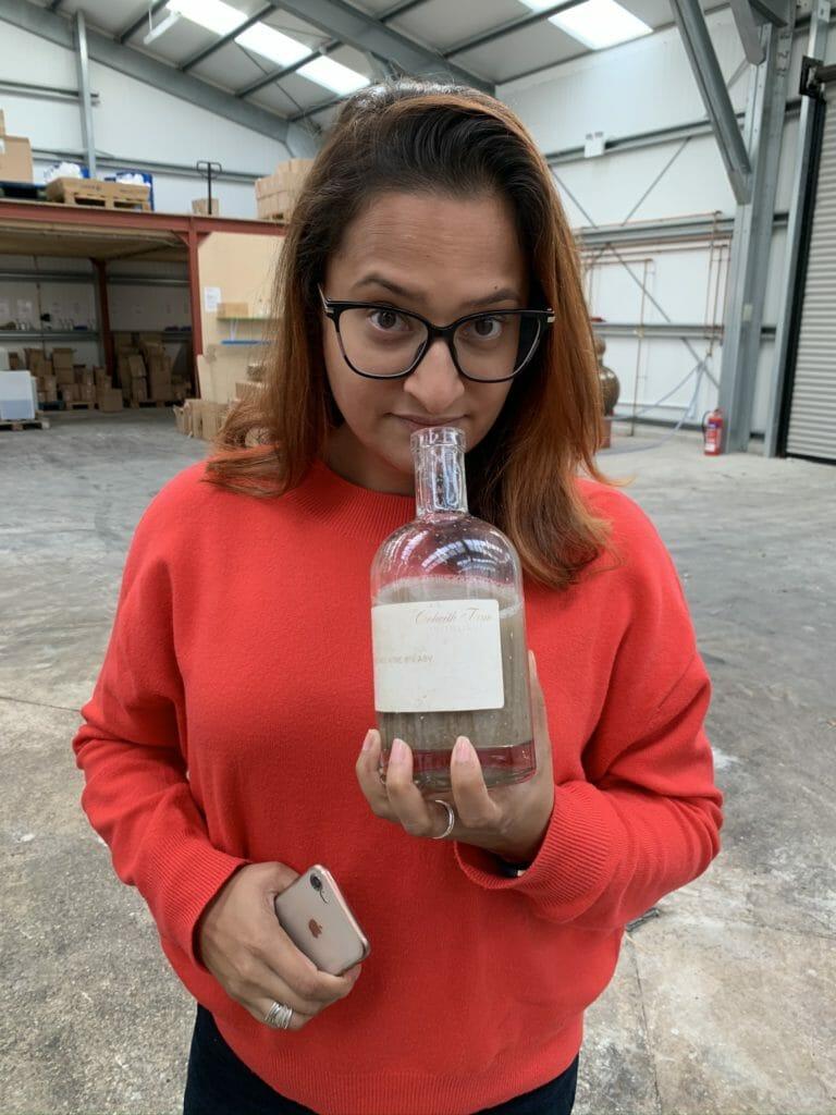 Meena smelling the potato wine