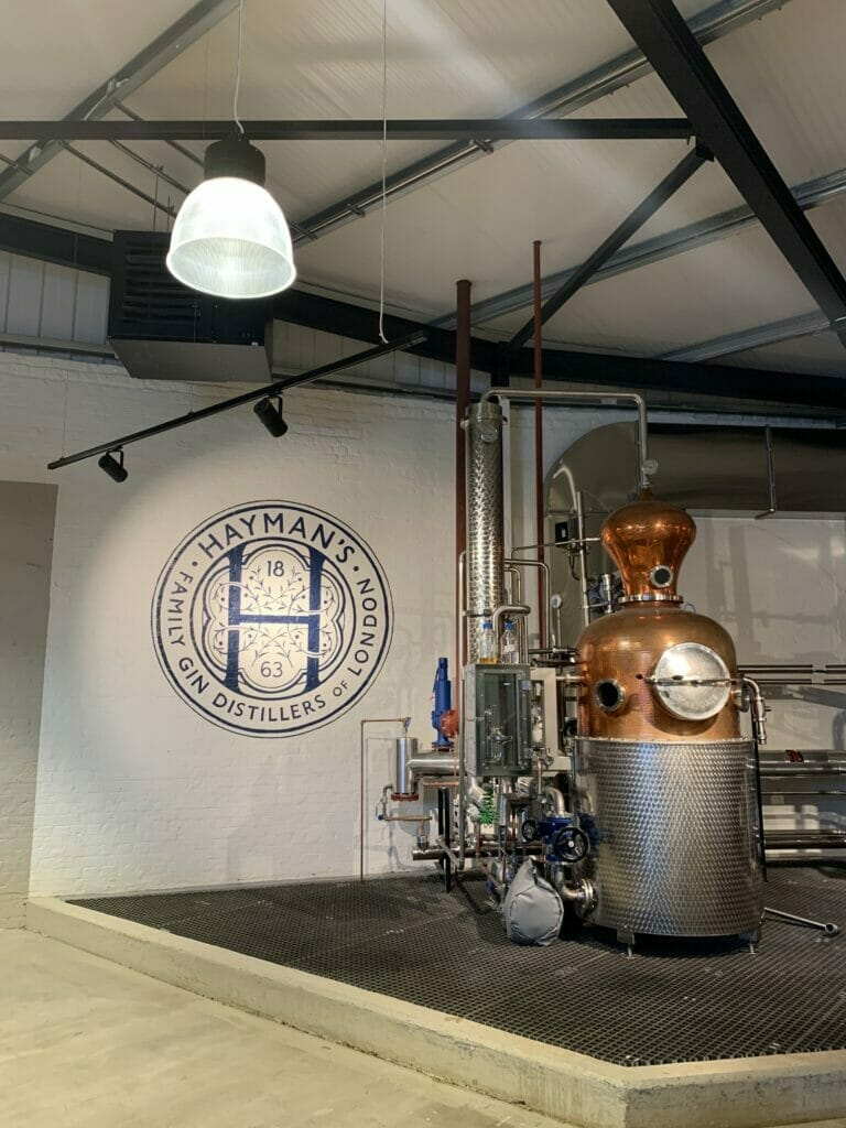 Copper still and Hayman's sign at the distillery