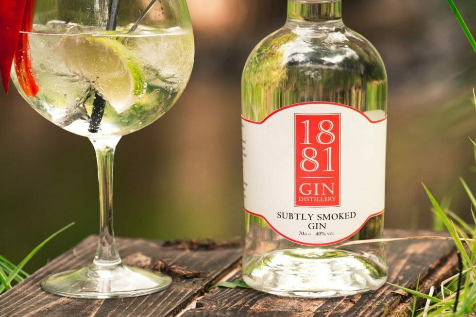 1881 Subtly Smoked gin bottle and perfect serve outside