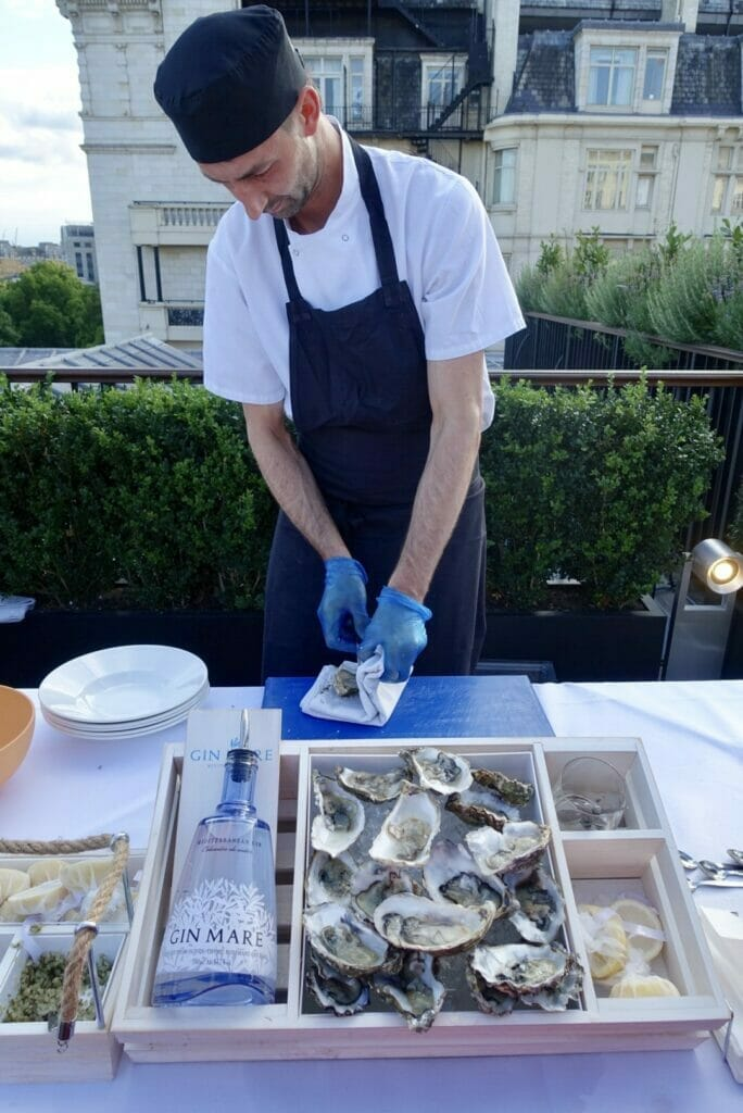Chef shucking an oyster