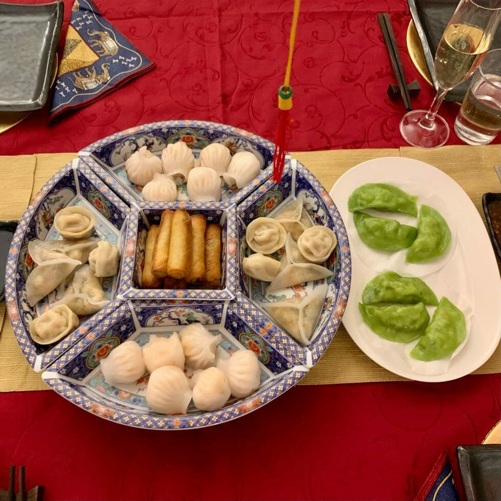 Serving dish with dim sum on a red and gold table cloth