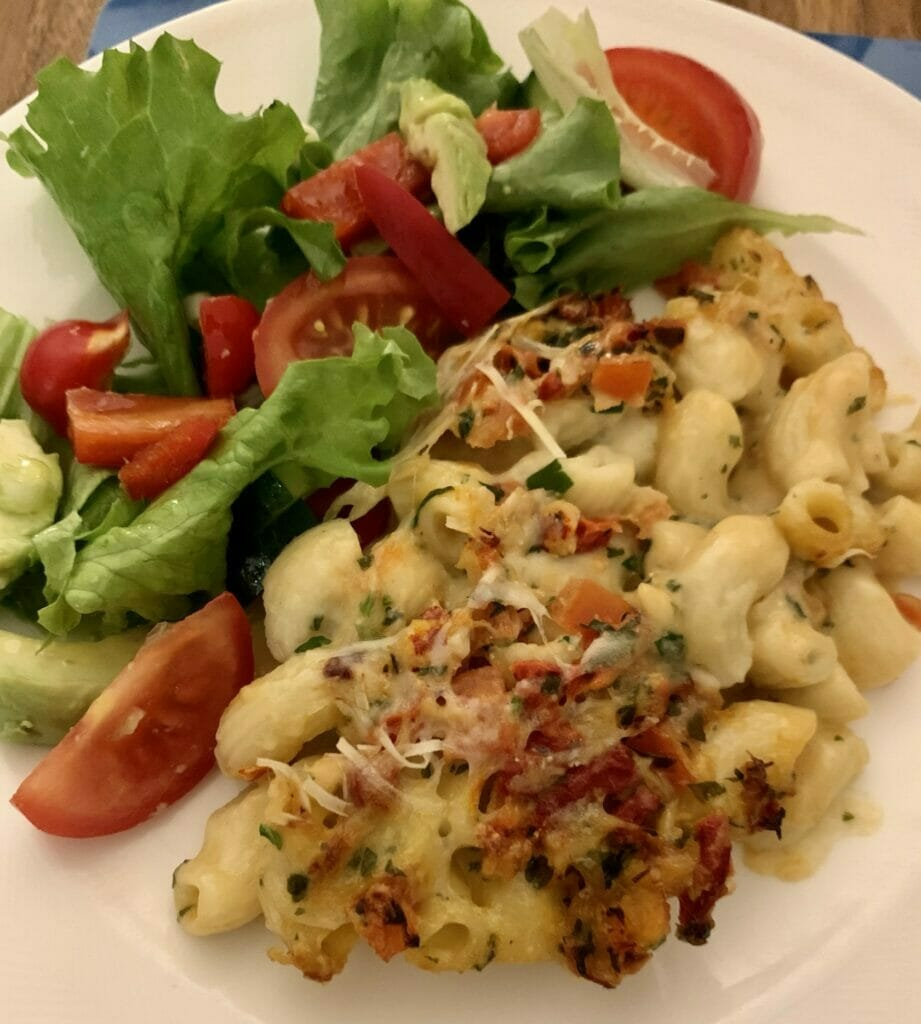 Plate of mac and cheese with mixed salad