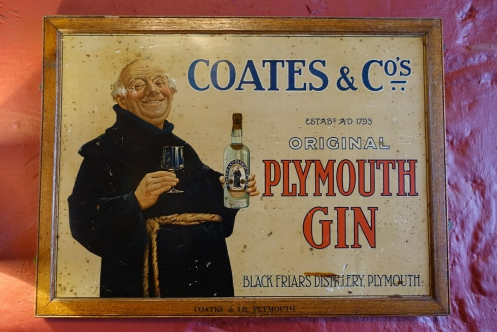 Old sign showing a Black Friar holding a Plymouth gin bottle
