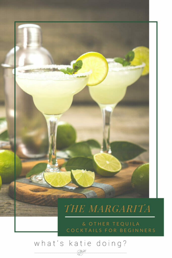 2 margarita cocktails with shaker behind and limes around