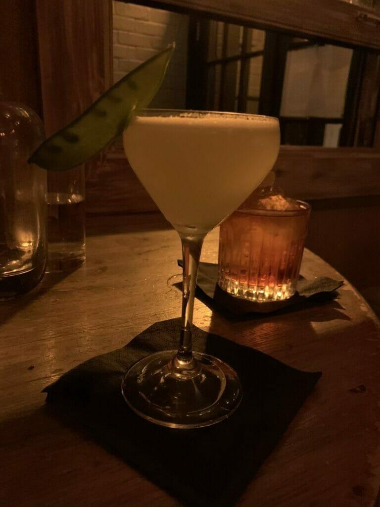 Cocktail with mange tout as garnish